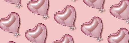 Pink air balloon in the shape of a heart on a pink background. Pattern. Love concept, valentines day. Banner. Flat lay, top view. Banco de Imagens