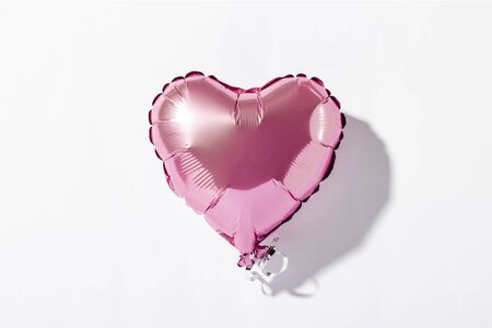 Air balloon heart on a white background. Natural light. Concept of Valentines Day, love, wedding. Photozone. Flat lay, top view.