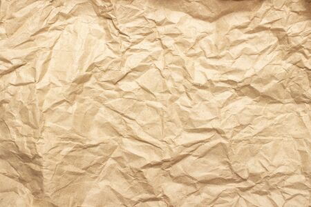 Crumpled brown craft paper. Texture, banner. Can be used as background. Top view, flat lay.