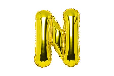 Golden air balloon, letter N on a white isolated background. Concept holiday, birthday, anniversary. Zdjęcie Seryjne