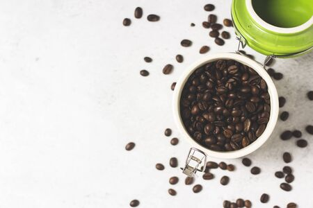 jar with fresh coffee beans and coffee beans are scattered on a concrete background. Banner. Concept of fresh coffee, breakfast, plantation. Top view, flat lay. Reklamní fotografie - 150120793