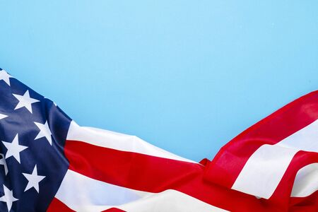 USA flag on a blue background. United States. Concept Memorial Day, Independence Day, July 4th. Flat lay, top view. 版權商用圖片