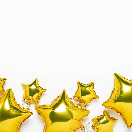 Air golden balloons star shape and candy on a white background. Concept for holiday, party, photo zone, decoration. Banner Flat lay, top view. Banque d'images