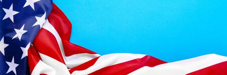 USA flag on a blue background. United States. Concept Memorial Day, Independence Day, July 4th. Banner. Flat lay, top view.