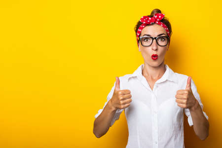 Young woman with a bandage on her head makes a gesture All is well on a yellow background. Banner.