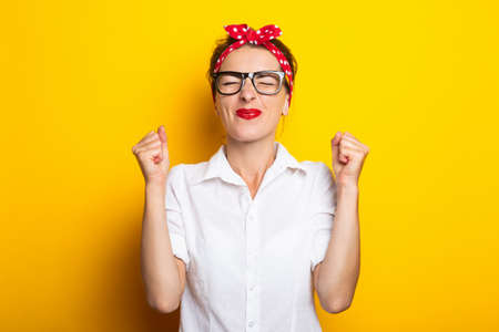 Young woman with a headband rejoices on a yellow background. Banner.
