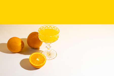 glass of cocktail or orange juice in the sunlight. Summer concept, vacation at sea. Banner. Flat lay, top view. Stock Photo