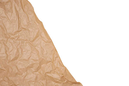 Crumpled brown craft paper isolated on white background.