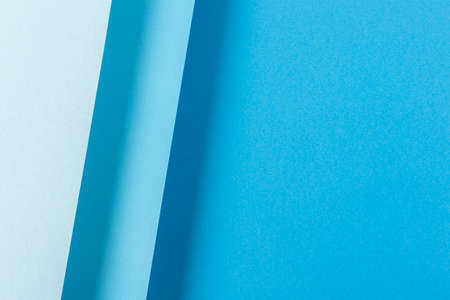 Colorful blue folded paper material design. Top view, flat lay.