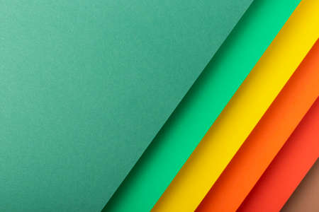Colorful design of the folded paper material. Top view, flat lay.
