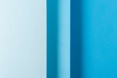 Colorful blue folded paper material design vertically. Top view, flat lay.