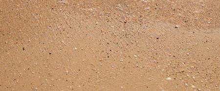 Summer day beach sand texture. Top view, flat lay. Banner.