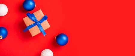 Gifts and toys on a red background. Top view, flat lay. Banner.
