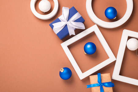 Concept of geometric shapes, Christmas tree decorations and gifts. Banner. Flat lay, top view.
