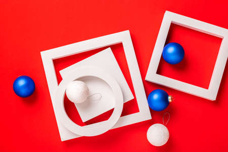 Christmas gifts and toys on a red background. Top view, flat lay. Фото со стока