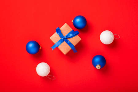 Gifts and toys on a red background. Top view, flat lay.
