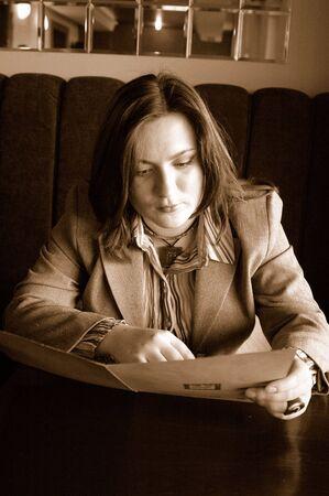 woman reading the menu photo