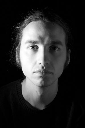 stagy: close-up portrait of young man, isolated on black