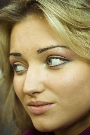 pity: Close-up of beautiful woman face.Close-up of beautiful woman face.