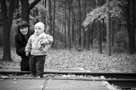 A young mother with her baby child. Black and white photo photo