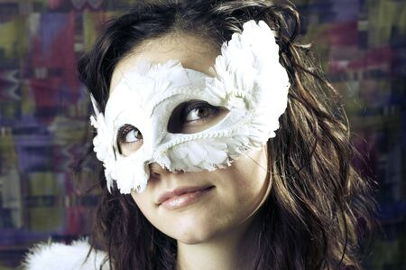 frizz: Studio portrait of a girl in a mask Stock Photo