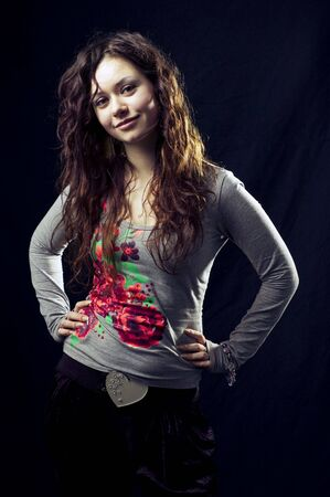 frizz: Portrait of a young dark-haired girl in the black background Stock Photo