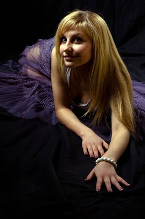 lascivious: Portrait of a young blond girl in the black