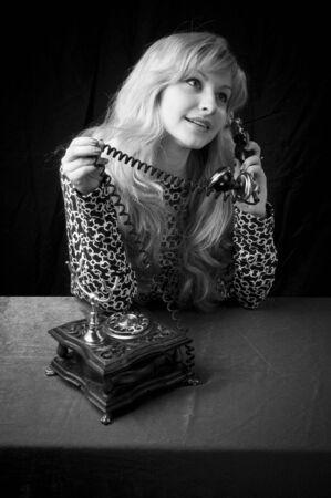 blackandwhite: beautiful caucasian woman talking on retro phone. Stock Photo