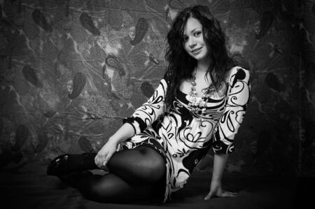 frizz: portrait of a young dark-haired girl. black and white photo.