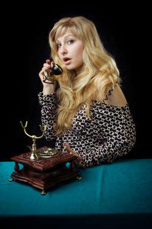 connexion: beautiful caucasian woman talking on retro phone. Stock Photo