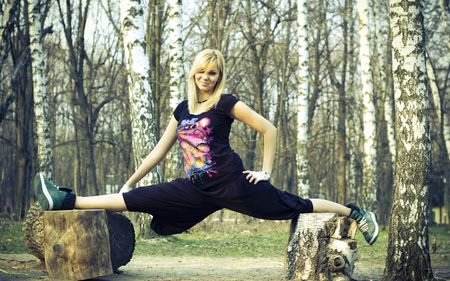 Blonde girl in the forest. Girl in splits.  photo