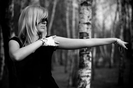 limber: girl limber up in a birch grove