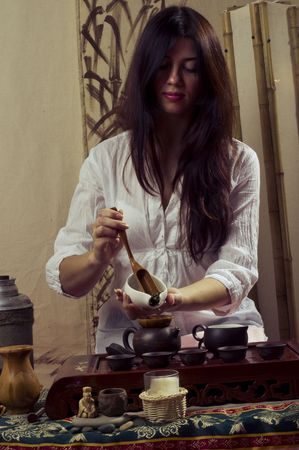 A young girl holds a Chinese tea ceremony Stock Photo - 6475801