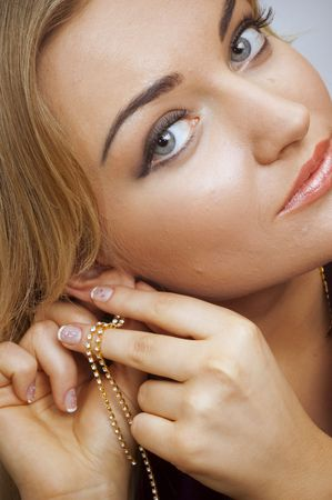 gorgeousness: closeup portrait of a girl with earrings with precious stones. Stock Photo