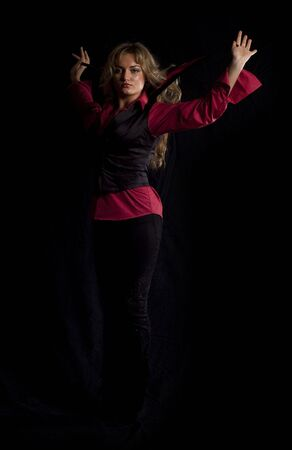melodramatic: portrait of a young gypsy girl in a red shirt