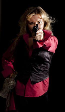 flint gun: portrait of a young girl in a red shirt with a gun