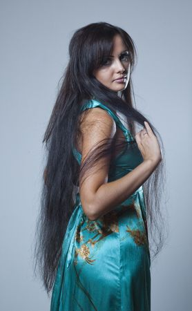 woman long hair: studio photos of a girl with long dark hair