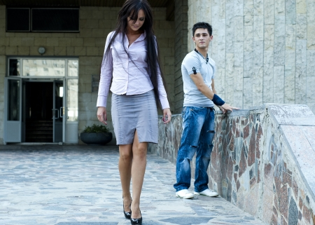 legs around: woman and a guy  Stock Photo