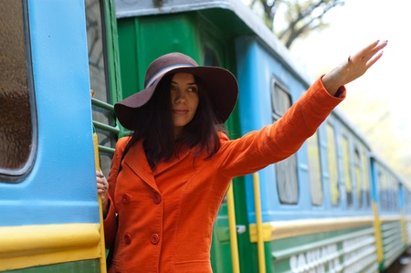 �aucasian: beautiful young woman near a train