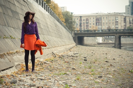 velours: Fashion girl in an orange skirt and a purple shirt. Stock Photo