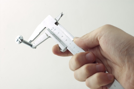 sliding caliper: measures the size of the screw with a caliper Stock Photo