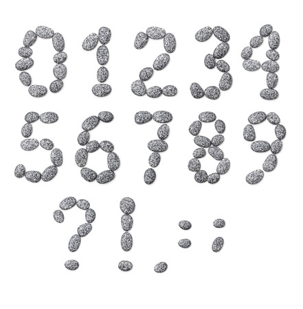 Letter made of little stones  On white  Numbers and punctuation marks  photo