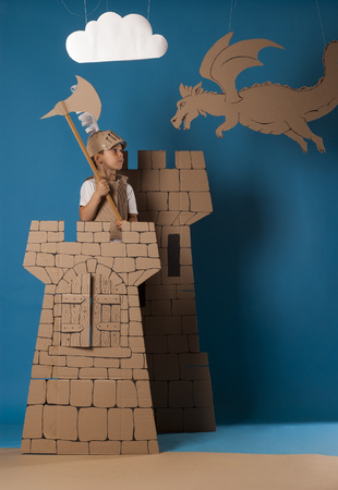 warder: photo of the boy in medieval knight costume made of cardboards. this decorations are made specially for this photosession by me.