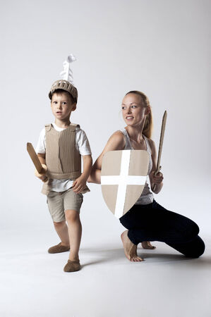 warder: photo of the boy in medieval knight costume made of cardboards with his mother. this decorations are made specially for this photosession by me.
