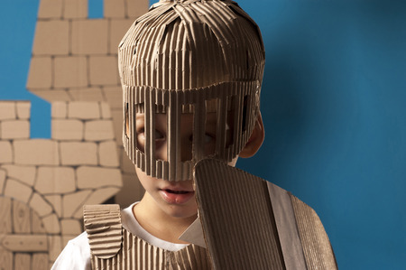 belfry: photo of the boy in medieval knight costume made of cardboards. this decorations are made specially for this photosession by me. Stock Photo