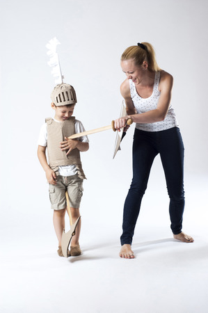 photo of the boy in medieval knight costume made of cardboards with his mother. this decorations are made specially for this photosession by me.