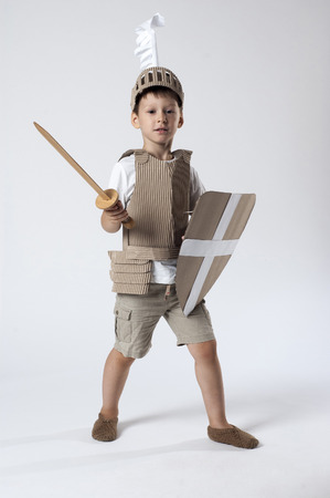 photo of the boy in medieval knight costume made of cardboards