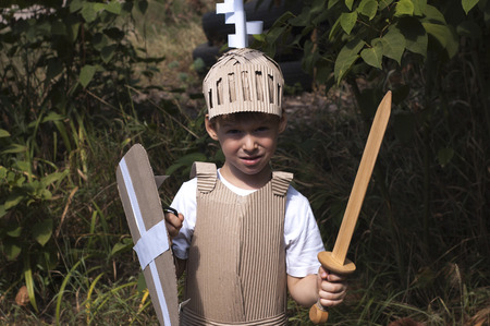 corrugated box: photo of the boy in medieval knight costume made of cardboards