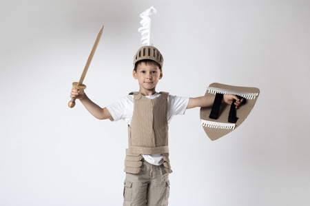 the boy in medieval knight costume made of cardboards