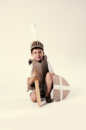 warder: photo of the boy in medieval knight costume made of cardboards
